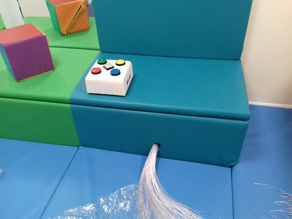 Padded seating area in calming sensory room